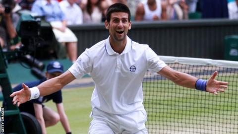 Novak Djokovic of Serbia celebrates championship point after winning Wimbledon.