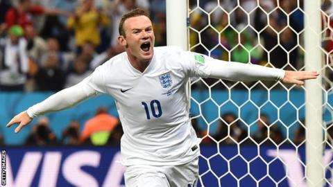 Wayne Rooney celebrates equalising against Uruguay