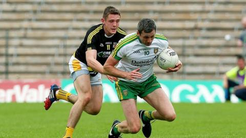 Antrim's Mark Sweeney attempts to dispossess Donegal's Christy Toye at St Tiernach's Park