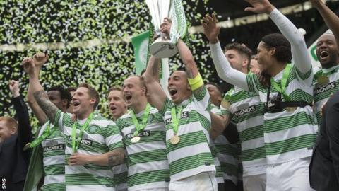 Celtic captain Scott Brown lifts the Scottish Premiership title
