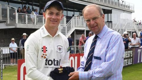 Patrick Grieshaber receives his cap from honorary treasurer Tony Elgood