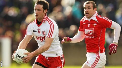 Tyrone forward Martin Penrose moves clear of Louth's Paddy Keenan