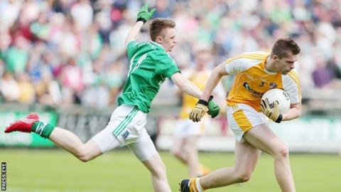Antrim's Ricky Johnston tries to break clear of Fermanagh's Barry Owens in this year's Ulster SFC game at Enniskillen