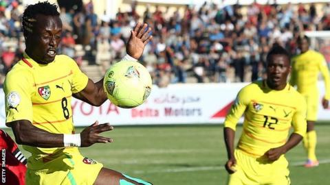 Togo midfielder Komlan Amewou (left)
