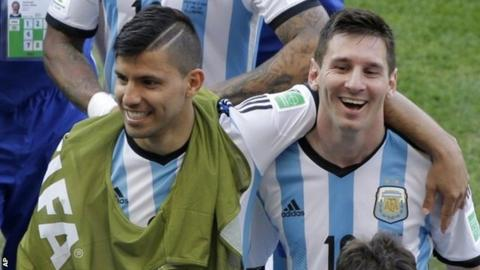Argentina's Lionel Messi, right, with team-mate Sergio Aguero