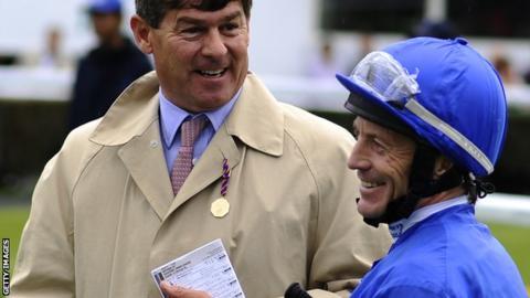 Simon Crisford (left) shares a joke with Keiren Fallon at Newbury racecourse