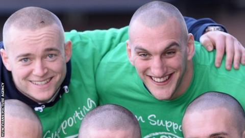 Owen Williams and Sam Warburton posing for picture after having their heads shaved for charity