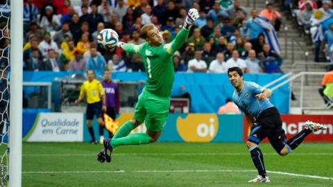 Luis Suarez of Uruguay scores his team's first goal past Joe Hart of England during the World Cup Group D match between Uruguay and England at Arena de Sao Paulo on 19 June