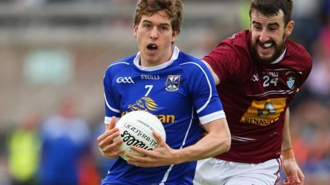 Cavan's Robert Maloney-Derham is challenged by Lorcan Smith