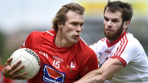 Conor Grimes of Louth in action against Ronan McNamee of Tyrone