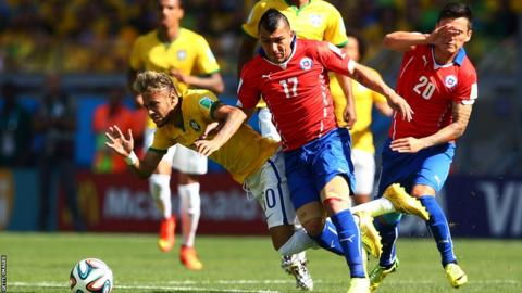 Cardiff City's Gary Medel challenges Brazil's Neymar for the ball during Chile's last 16 clash against the World Cup hosts
