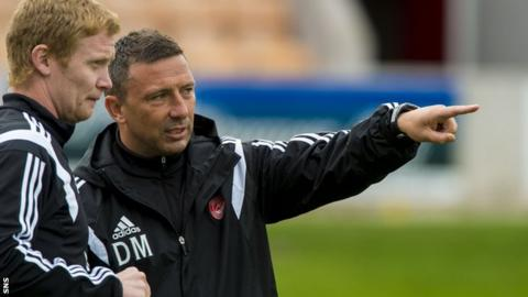 Aberdeen manager Derek McInnes with Barry Robson before the friendly with Arbroath