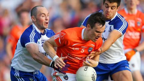 Monaghan pair Stephen Gollogly and Drew Wylie ensure there is no escape for Armagh's Mark Shields in the Ulster SFC semi-final at Clones