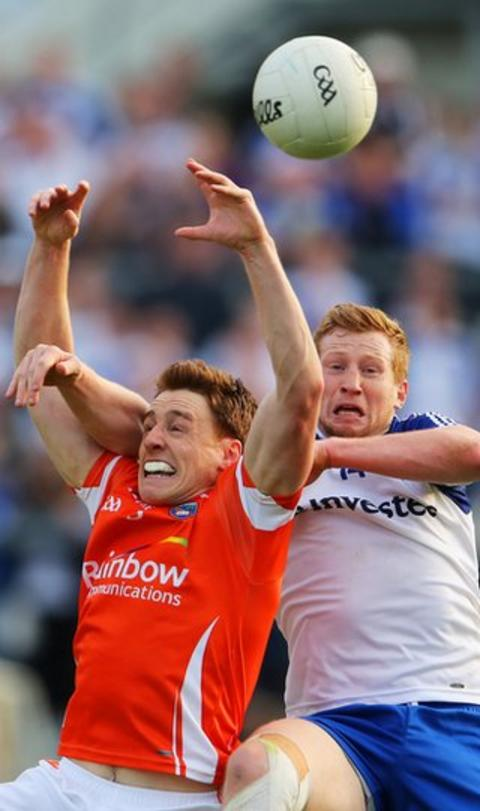 Armagh's Charlie Vernon and Monaghan forward Kieran Hughes battle for the high ball
