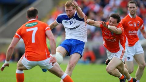Kieran Hughes gets his kick away but it may not travel far as Armagh's James Morgan comes in with the block in the 0-14 to 0-14 draw with holders Monaghan