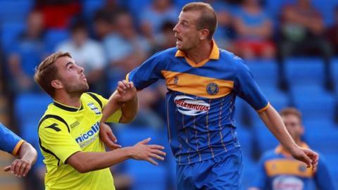 Birmingham City's Andrew Shinnie (left) challenges Shrewsbury's Luke Summerfield