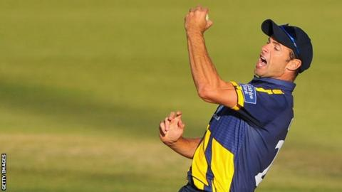 Dean Cosker celebrates a wicket for Glamorgan