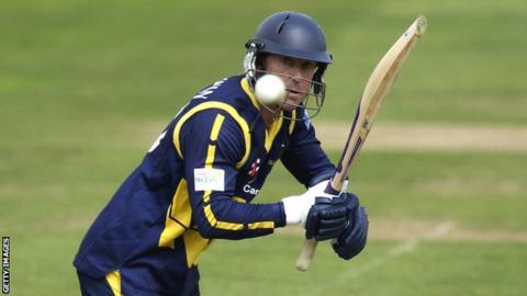 Glamorgan batsman Murray Goodwin watches the ball after playing a shot