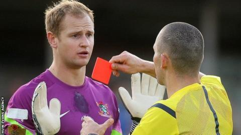 Aberystwyth Town goalkeeper Mike Lewis is sent off