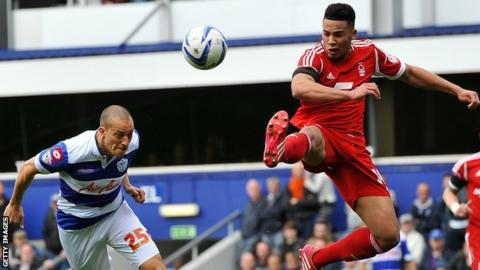 Jamaal Lascelles (right) attempts to thwart QPR's Bobby Zamora