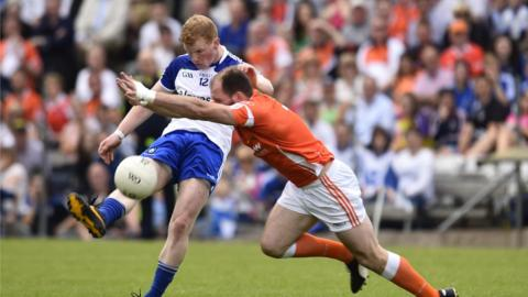 Paudie McKenna tries to clear the ball for Monaghan as Ciaran McKeever tries to intervene for the Orchard county