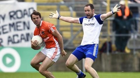 Armagh's Kevin Dyas plots his next move as Monaghan's Dick Clerkin looks on