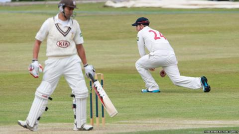 Surrey's Vikram Solanki is caught by Chris Cooke of Glamorgan in the County Championship game at Colwyn Bay.