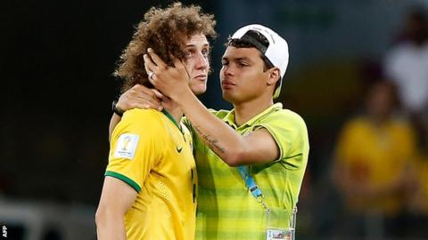 Brazil's David Luiz is comforted by Thiago Silva following the 7-1 defeat to Germany in the World Cup semi-final