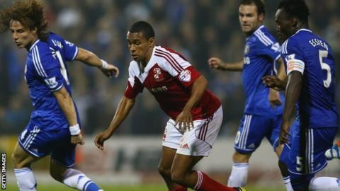 Nathan Thompson playing for Swindon against Chelsea