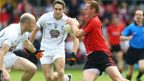 Kildare pair Hugh McGrillen and Gary White close in on Benny Coulter