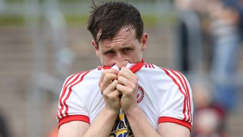 A dejected Colm Cananagh leaves the pitch after Tyrone's 0-10 to 0-13 defeat by Armagh in the All-Ireland Championship