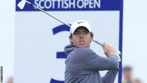 McIlroy watches his tee shot on the third hole on Sunday