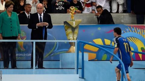 Argentina's Lionel Messi makes the walk up the stairs to receive his loser's medal
