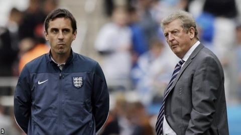 England boss Roy Hodgson (right) and coach Gary Neville