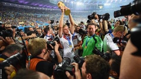Germany's Christoph Kramer holds aloft the World Cup