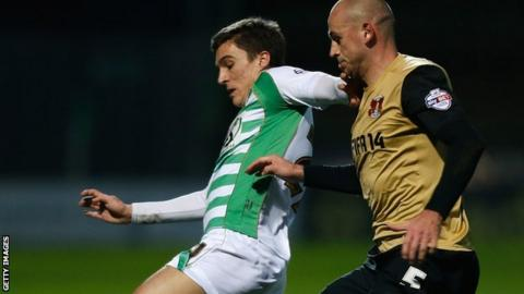 Adam Morgan (left) playing for Yeovil Town
