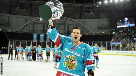 Giants captain Adam Keefe celebrates with the Elite League trophy in a fourth title success for Belfast