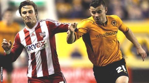 Zeli Ismail (right) in action for Wolves against Sam Saunders Brentford
