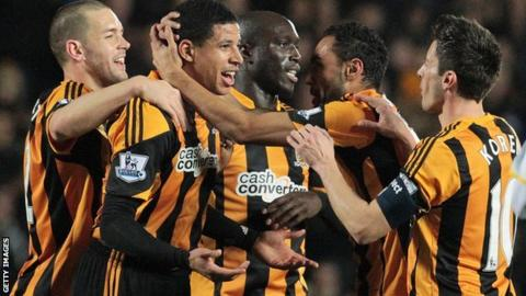 Hull players celebrate a goal
