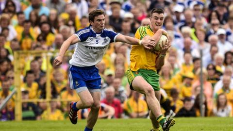 Monaghan's Dessie Mone attempts to halt the progress of Donegal's Leo McLoone