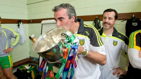 Donegal manager Jim McGuinness kisses the Anglo Celt Cup in the Donegal dressing room after the game