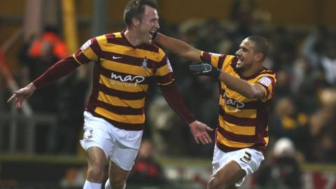 Garry Thompson (left) celebrates scoring against Arsenal with Bradford team-mate James Meredith in 2012