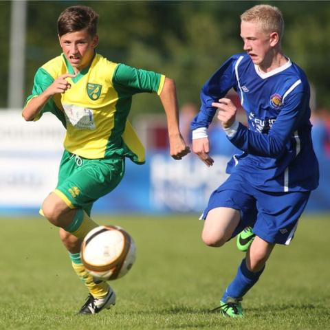 Norwich City player Joe Redmond in a chase for the ball with Loughside's Aaron McCauley during an Under-15 game
