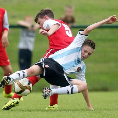 Maiden City Academy's Darragh Coyle battles for possession with Conor Smith of Hearts