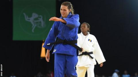 Scotland's Kimberley Renicks celebrates after making it to the -48kg final