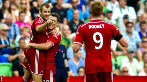 Niall McGinn celebrates after netting Aberdeen's second goal against Groningen