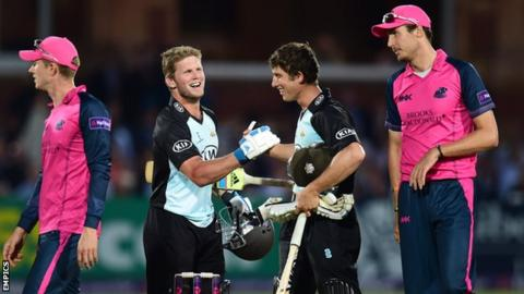 Surrey's Stuart Meaker and Zafar Ansari celebrate Surrey's win