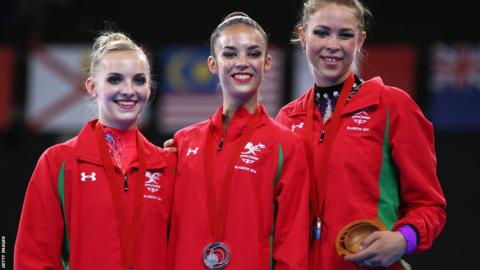 Nikara Jenkins, Laura Halford and Frankie Jones won Wales' first medal of the 2014 Commonwealth Games with a team silver in rhythmic gymnastics.