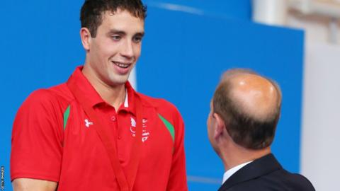 Calum Jarvis is presented with his 200m men's freestyle bronze medal - Wales' first of the Games in the swimming pool - by the Earl of Wessex.