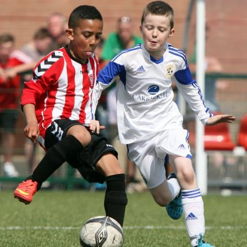 Tristar's Aaron Reid and Oran Hunter of Sion Swifts in action during the Foyle Cup Under-10 Plate final